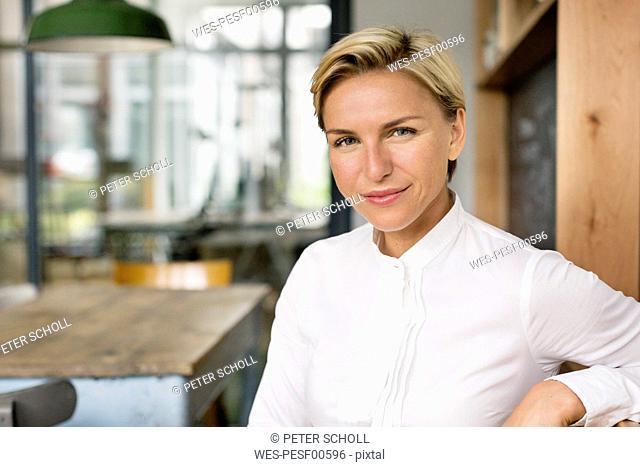 Portrait of confident blond woman