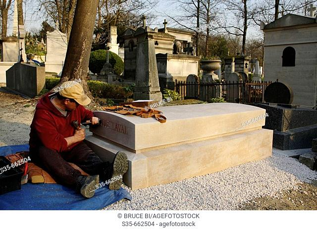 A mason working on a new tomb in Cimetiere du Pere Lachaise. Paris. France