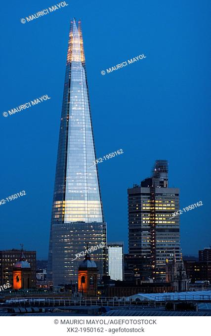 Shard and office building at dusk, London, UK