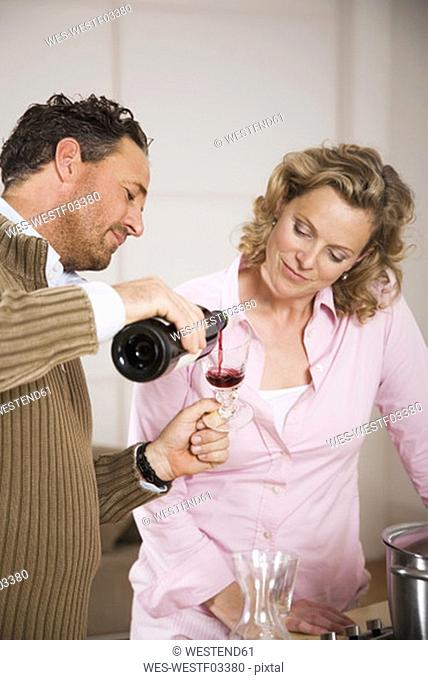 Couple, man pouring wine in glass