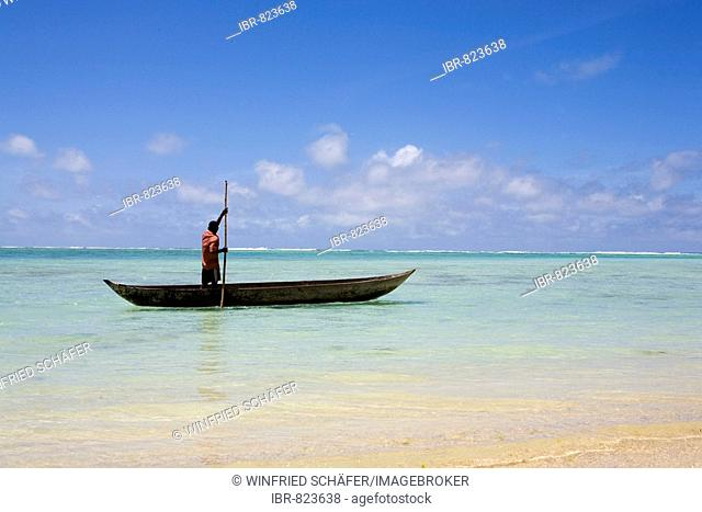 Man in a logboat or dugout boat, Nosy Nato, Madagascar, Africa