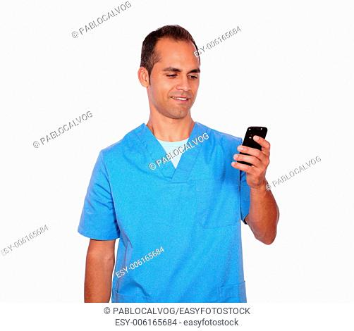 Portrait of a smiling young nurse sending message on cellphone on isolated background