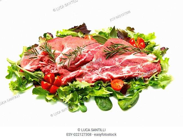 sliced raw meat with salad