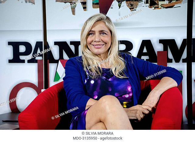 Actress and TV host Mara Venier (Mara Povoleri) talking to Alfonso Signorini, director of Chi, and Giorgio Mulè, director of Panorama