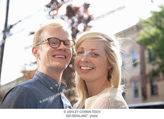 Portrait of happy young couple on street
