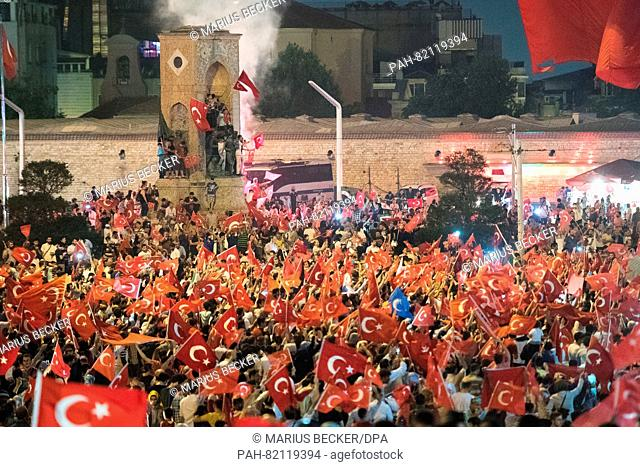 People shout slogans and hold flags during a demonstration at Taksim Square in Istanbul, Turkey, 17 July 2017. Turkish authorities state they have regained...