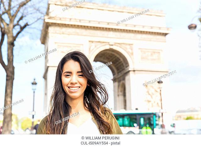 Portrait of young woman at Arc de Triomphe, Paris, France