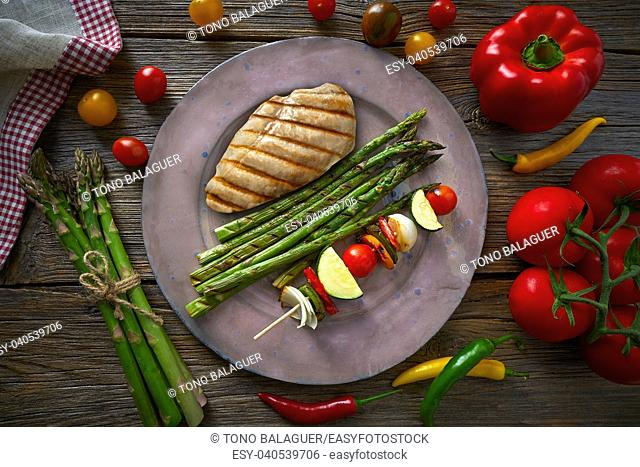 grilled chicken breast with brochette vegetable with grill asparagus