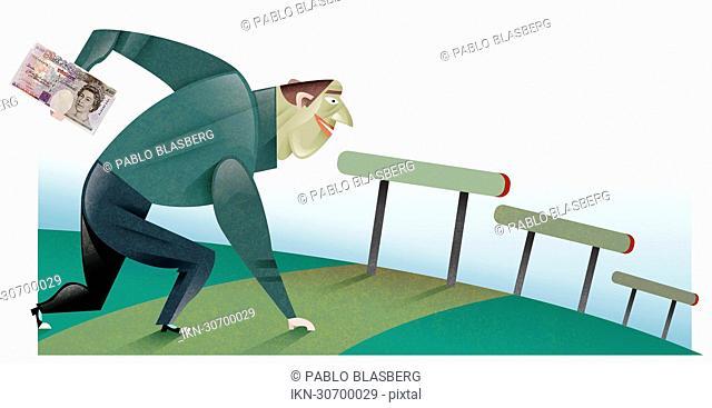 Man holding british pound next to hurdles