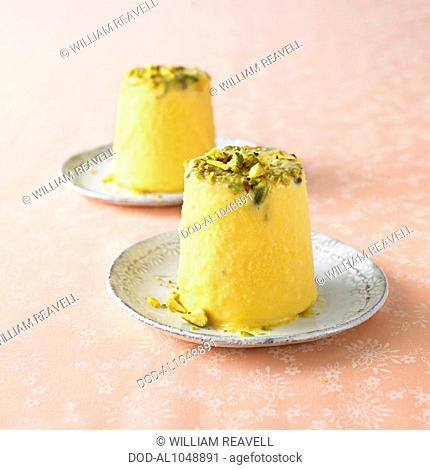 Two plates of Kulfi, an Indian frozen dairy dessert