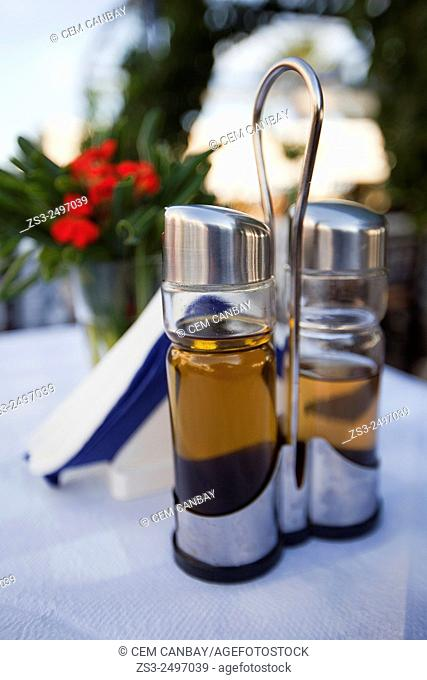 Olive oil and vinagre on the table in a restaurant, Naxos, Cyclades Islands; Greek Islands, Greece, Europe
