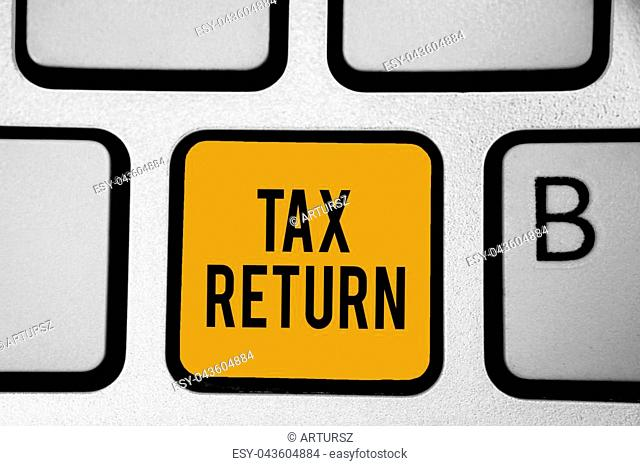 Text sign showing Tax Return. Conceptual photo which taxpayer makes annual statement of income circumstances Keyboard orange key Intention create computer...