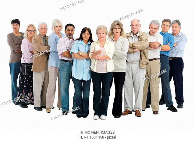 A row of people standing with their arms crossed