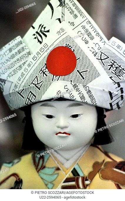 Kyoto, Japan, doll with a paper hat, sold in a shop...