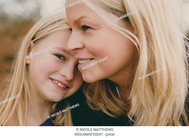 Happy mother with daughter outdoors