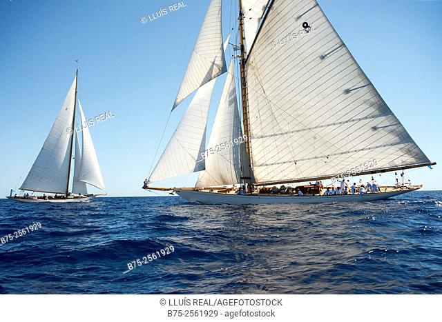Two vintage sailing boats in a Panerai race, at the Mediterranean Sea. Menorca, Biosphere Reserve, Baleares, Spain, Europe