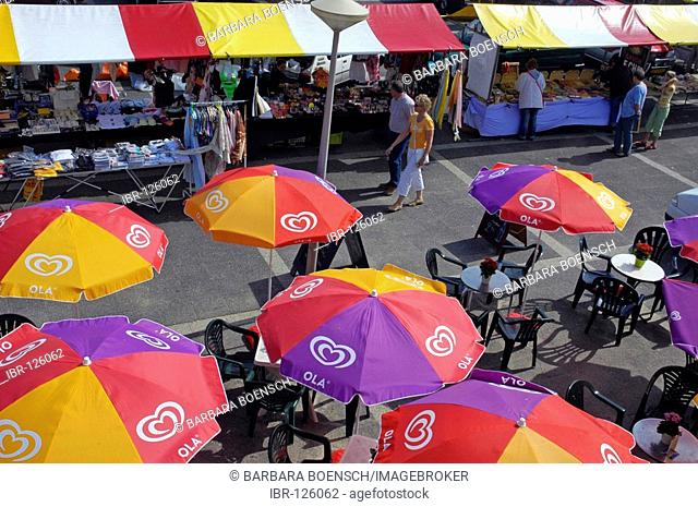 People and colourful parasols at a market, Noordwijk, South Holland, Holland, The Netherlands