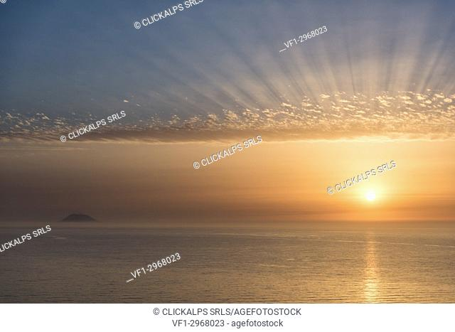 Zambrone, province of Vibo Valentia, Calabria, Italy, Europe. Sunset in Zambrone with a view of the Stromboli volcano