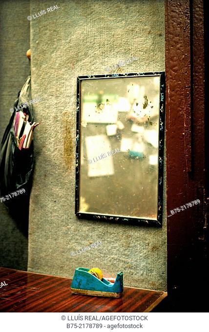 Handwritten notes reflected in a mirror in a small business in the Medina of Fez, Morocco, Africa