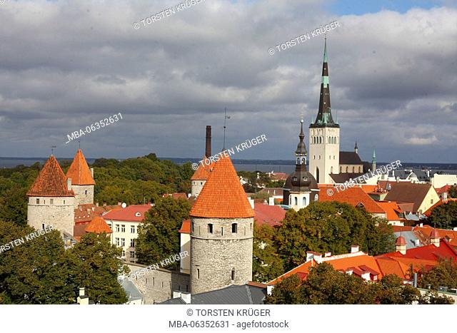 View of the cathedral mountain on the lower city, Old Town with the St. Olaf's Church or Oleviste Kirik, and towers of the city wall, Tallinn, Estonia, Europe