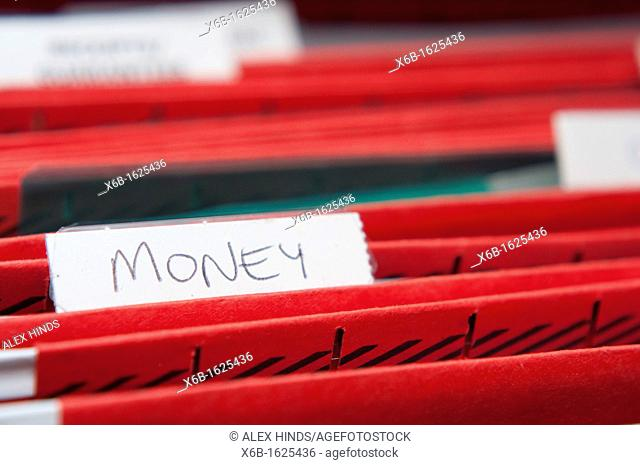 Home filing system with focus on the word money for personal finance concepts