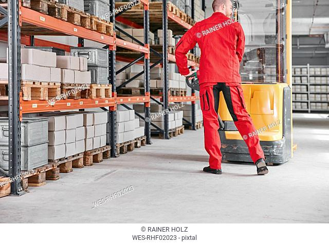 Man in factory using forklift