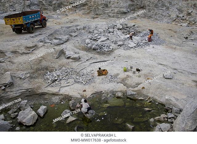 A Distress sessonal Migration Family works in a stone quarry and the childerns are playing near the work area at out skrit of Bangalore Bangalore is a fast...