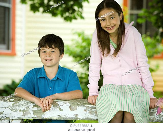 Portrait of a girl and a boy smiling