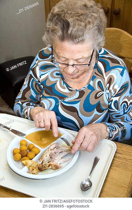 old woman having a meal in house for the elderly, holland