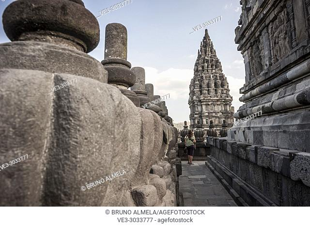 A young woman in Prambanan Hindu Temple Coumpounds (UNESCO World Heritage Site), Special Region of Yogyakarta,Central Java, Indonesia