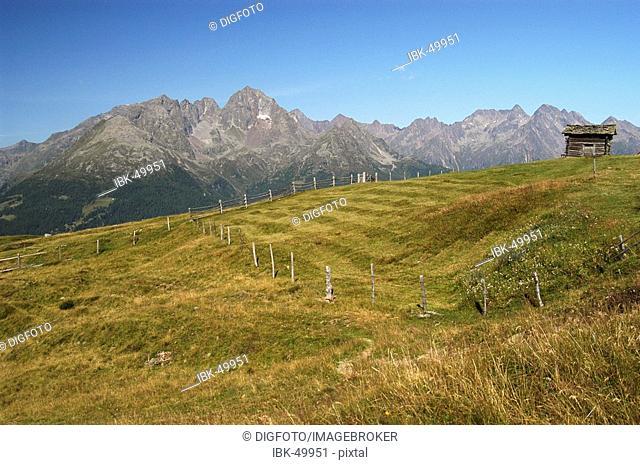 Alpine hut in front of mountain range, national park Hohe Tauern, Austria