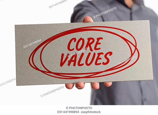 The concept of business, technology, the Internet and the network. Young businessman showing inscription: Core values