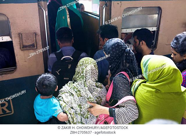 DHAKA, BANGLADESH - JUNE 30 : Bangladeshi people ride on train to travel their village to celebrate festival Eid al-Fitr in Dhaka, Bangladesh on June 30, 2016
