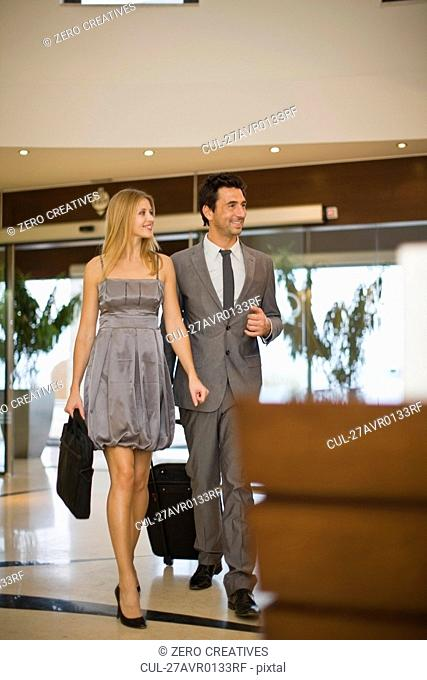 Couple arriving at hotel