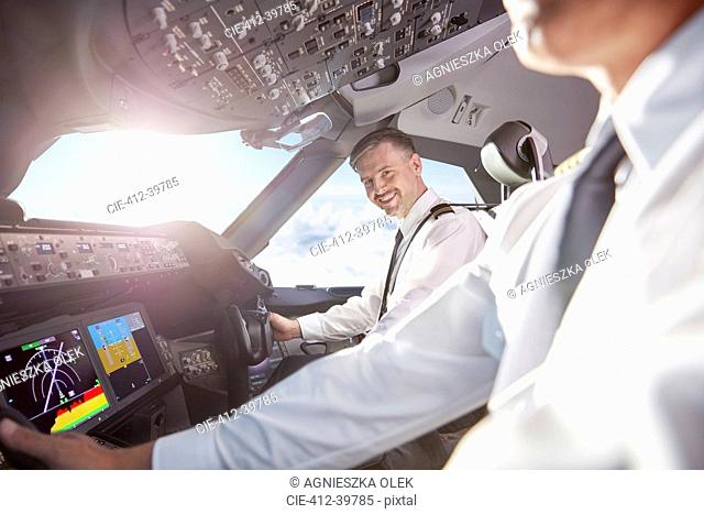 Portrait smiling, confident pilot in airplane cockpit