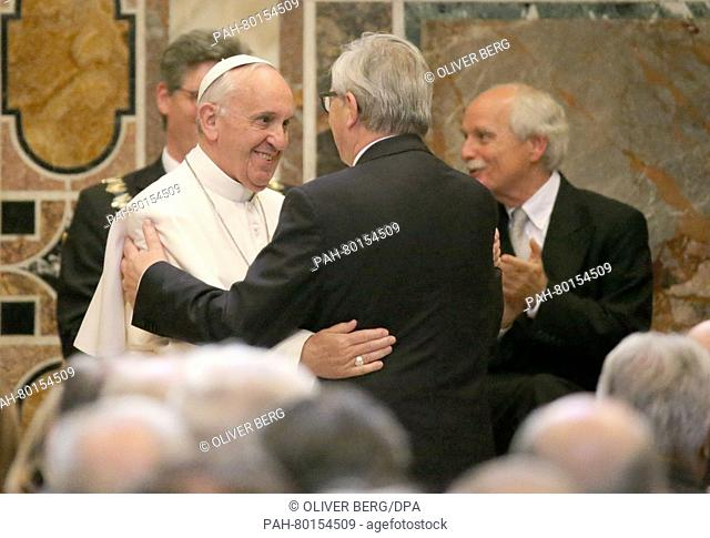 The President of the European Comission Jean-Claude Juncker (2.f.r).embraces Pope Francis (2.f.l) while the Lord Mayor of Aachen, Marcel Philipp (CDU