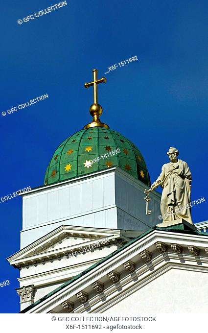 Statue of the apostel Saint Petrus with the key on the roof of the Helsinki Lutheran Cathedral, Helsinki, Finland
