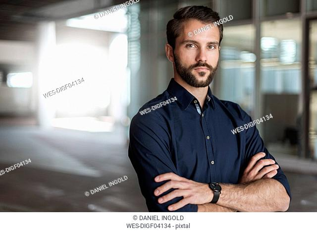 Portrait of serious young businessman