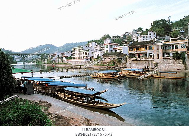Boats docked by harbor, The scenery of the old city near Tuo River, Fenghuang, Xiangxi Prefecture, Hunan Province, People's Republic of China