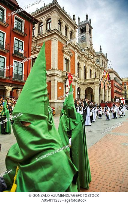 Holy Week procession passing by the Town Hall in Main Square, Valladolid. Castilla-Leon, Spain