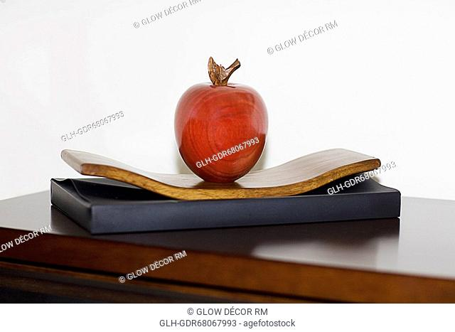 Artificial apple on a table