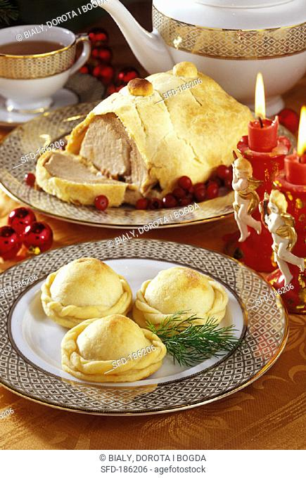 Christmas pies and roast pork in puff pastry
