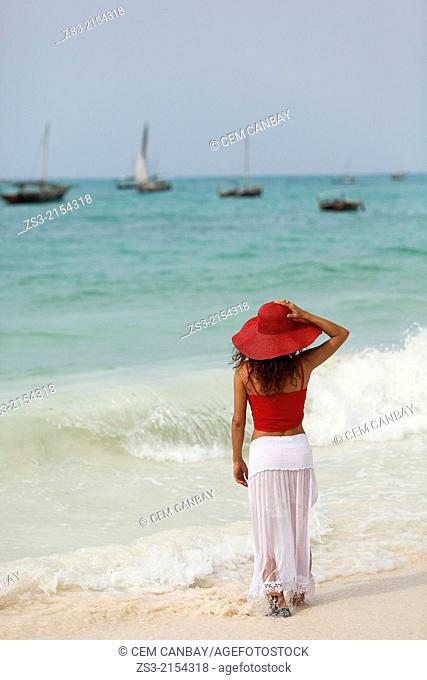 Woman walking on the beach, Nungwi, Zanzibar Island, Zanzibar Archipelago,Tanzania, East Africa