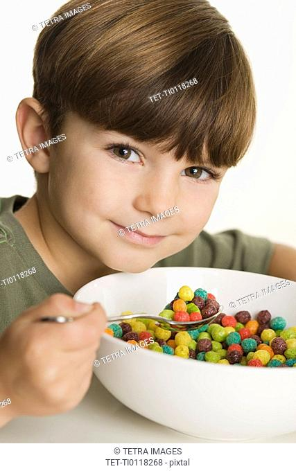 Portrait of boy eating cereal