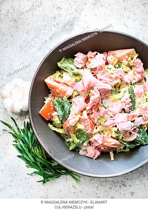 Bowl of fresh salad with ham