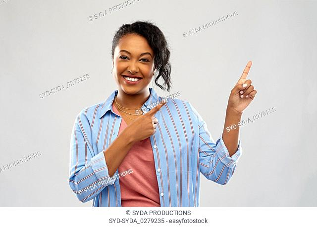 happy african american woman pointing finger up