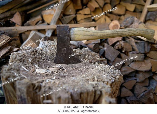 Switzerland, chopping block with hatchet