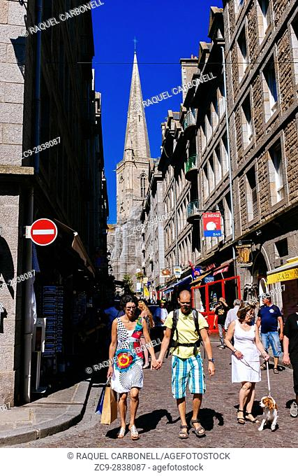 Tourists in the big street and the cathedral at back, Saint Malo, Ille-et-Vilaine, Brittany, France
