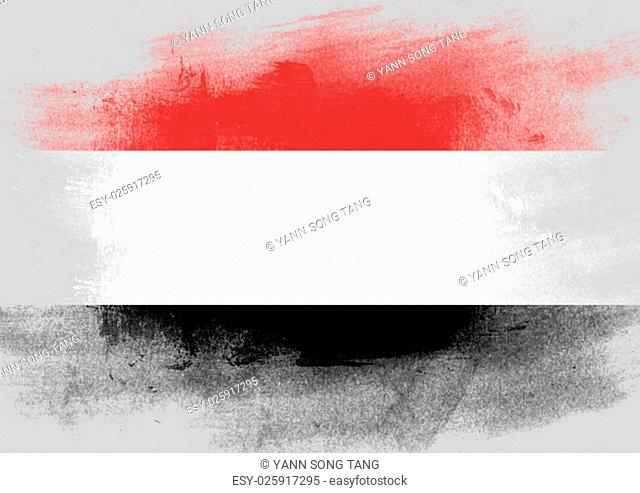 Flag of Yemen painted with brush on solid background