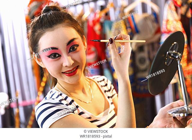 Beijing Opera actor are backstage makeup